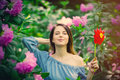 Woman with pinwheel in blossom garden Royalty Free Stock Photo