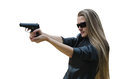 The woman with a pistol young in dark sun glasses it is isolated on white background Stock Photos