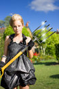 Woman with pitchfork Stock Photo