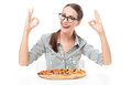 Woman with pizza and ok hand sign young over white background Stock Photography