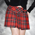 Woman in plaid skirt. Royalty Free Stock Photography