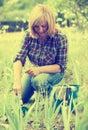 Woman planting cornflag