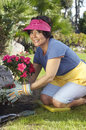 Woman Planting Flower Plant Stock Photos