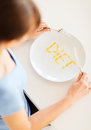 Woman with plate and meds sport healthcare diet concept Royalty Free Stock Photo