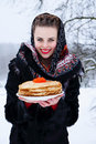 Woman with a plate of pancakes Royalty Free Stock Photo