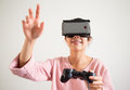 Woman play game with joystick and vr device