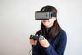 Woman play game with vr device