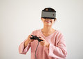 Woman play tv game on joystick and vr device