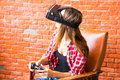 Woman play video game with joystick and VR device