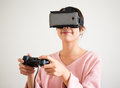 Woman play with vr device and joystick