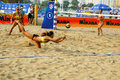Woman player save in beach volleyball game Royalty Free Stock Photo