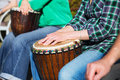 Woman playing on Africa Jambe Drum Royalty Free Stock Photo