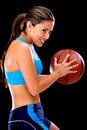 Woman playing basketball Stock Photos