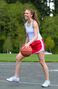 Woman playing basketball Stock Photo