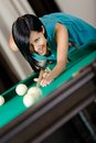 Woman playing billiard spending free time on gambling Stock Images