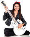 Woman playing an electric guitar Stock Photography