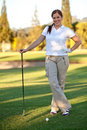 Woman playing golf Royalty Free Stock Images