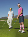 Woman playing golf with male friend young women on golfcourse Stock Photography