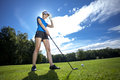 Woman playing golf pretty on field Royalty Free Stock Photography