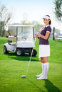 Woman playing golf young putting ball Stock Photo