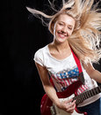 Woman Playing the Guitar Stock Images