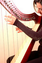 Woman playing a harp Royalty Free Stock Image