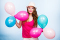 Woman playing with many colorful balloons Royalty Free Stock Photo