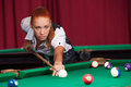 Woman playing pool confident young aiming the billiard ball with cue Stock Photos