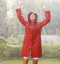 Woman playing in rain Stock Photos