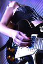 Woman playing rock guitar Royalty Free Stock Image