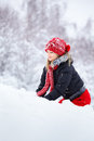 Woman playing in the snow Stock Photography