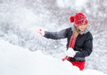 Woman playing in the snow Royalty Free Stock Photo