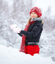 Woman playing in the snow Stock Photos