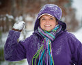 Woman playing in snow throwing snowball Stock Image