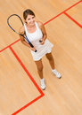 Woman playing squash happy at the court Royalty Free Stock Photo