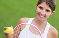 Woman playing tennis portrait of a and looking very happy Royalty Free Stock Images