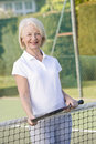 Woman playing tennis and smiling Stock Images