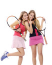 Woman playing tennis two young women isolated over a white background Stock Photo