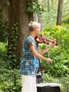 Woman playing the violin in Central Park Stock Photos