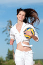 Woman playing volleyball on beach Royalty Free Stock Photos