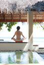 Woman playing yoga in maldives beach resort Royalty Free Stock Photo