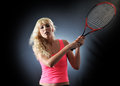 A woman plays tennis Stock Images