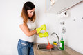 Woman With Plunger Near The Sink Royalty Free Stock Photo