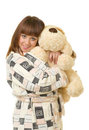 Woman in a plush bathrobe with toy dog Royalty Free Stock Photography