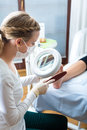 Woman in poidatry studio receiving pedicure podiatry treatment a day spa Stock Image