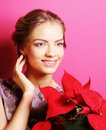 Woman with poinsettia young over pink background Stock Image