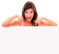 Woman pointing a banner casual at isolated over white background Royalty Free Stock Photos