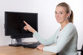 Woman pointing at empty screen of personal computer young attractive Stock Images