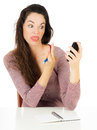 Woman pointing finger at mobile phone Stock Photo