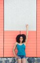 Woman pointing finger to copy space portrait of a smiling young blank poster Stock Image
